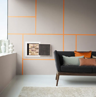 Couleur peinture gris dans salon. Pour la décoration d'un salon design peinture murale gris souris rehaussée par jeu de lignes couleur orange canapé et coussins gris et orange