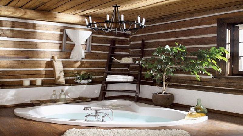 La tendance déco pour la salle de bain est au bois. clair, naturel, exotique avec une baignoire ïlot, des vasques blanches, le bois est à l'honneur dans la salle de bain