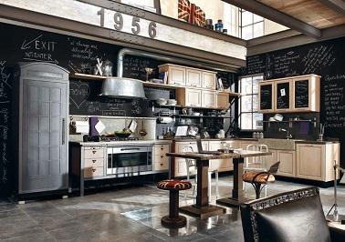 Vintage et originale, cette cuisine industrielle combine des éléments variés. De l'acier, du bois clair et une peinture ardoise il n'en faut pas plus pour une déco réussie.