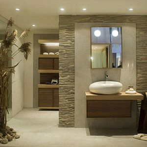 mur de pierre entre salle de bain et dressing